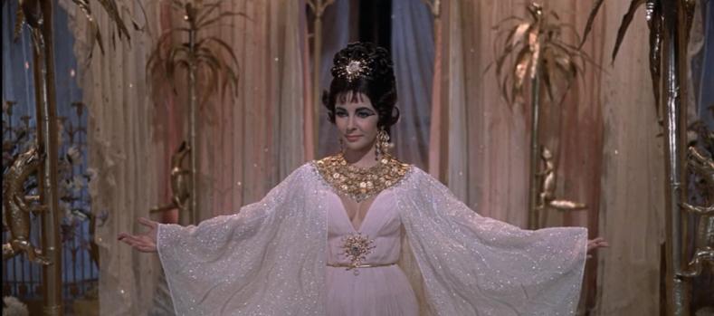 Cleopatra-ElizabethTaylor-GoldCoinDress-ArmsUp